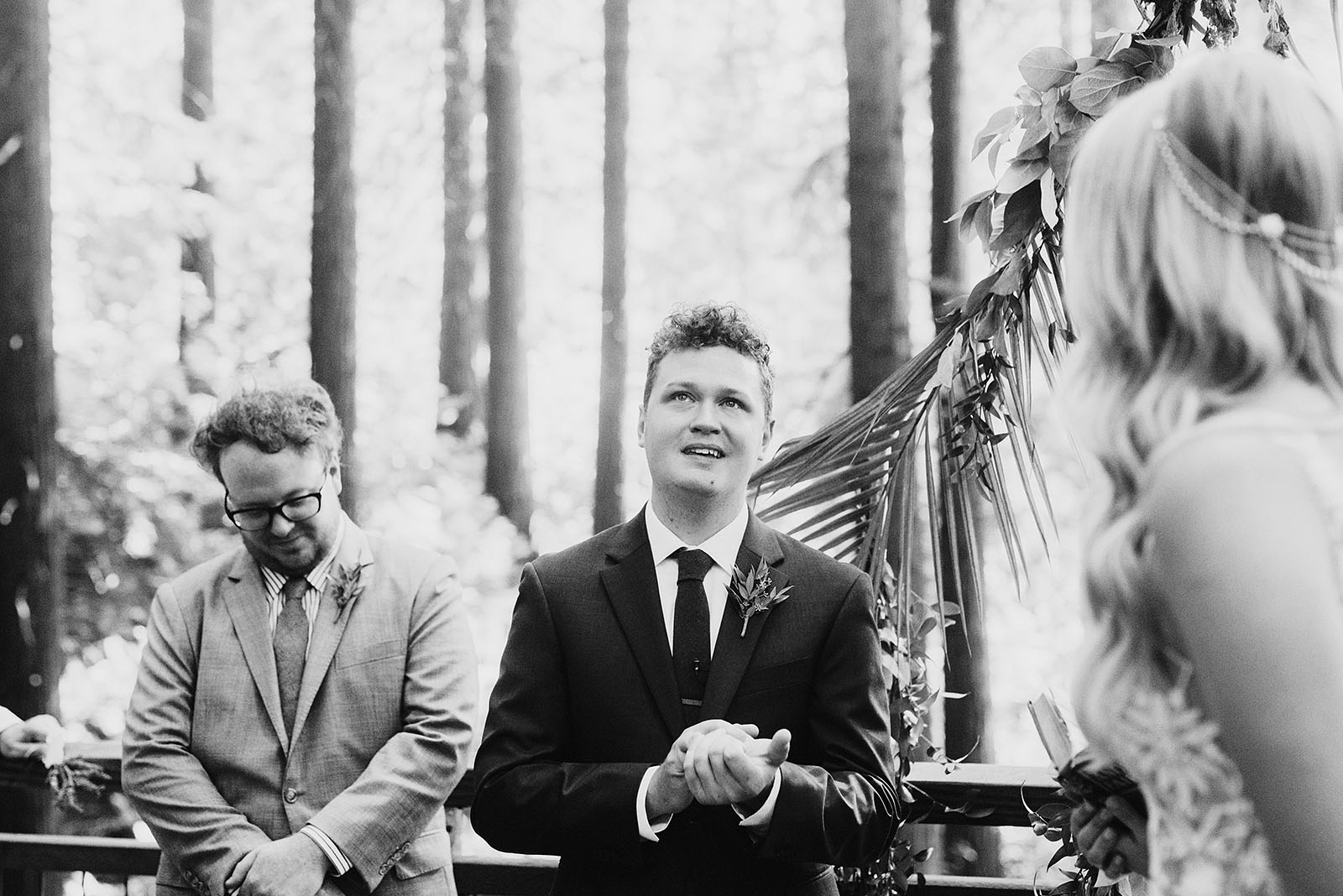 groom getting choked up during vows in Hoyt Arboretum - portland wedding photography
