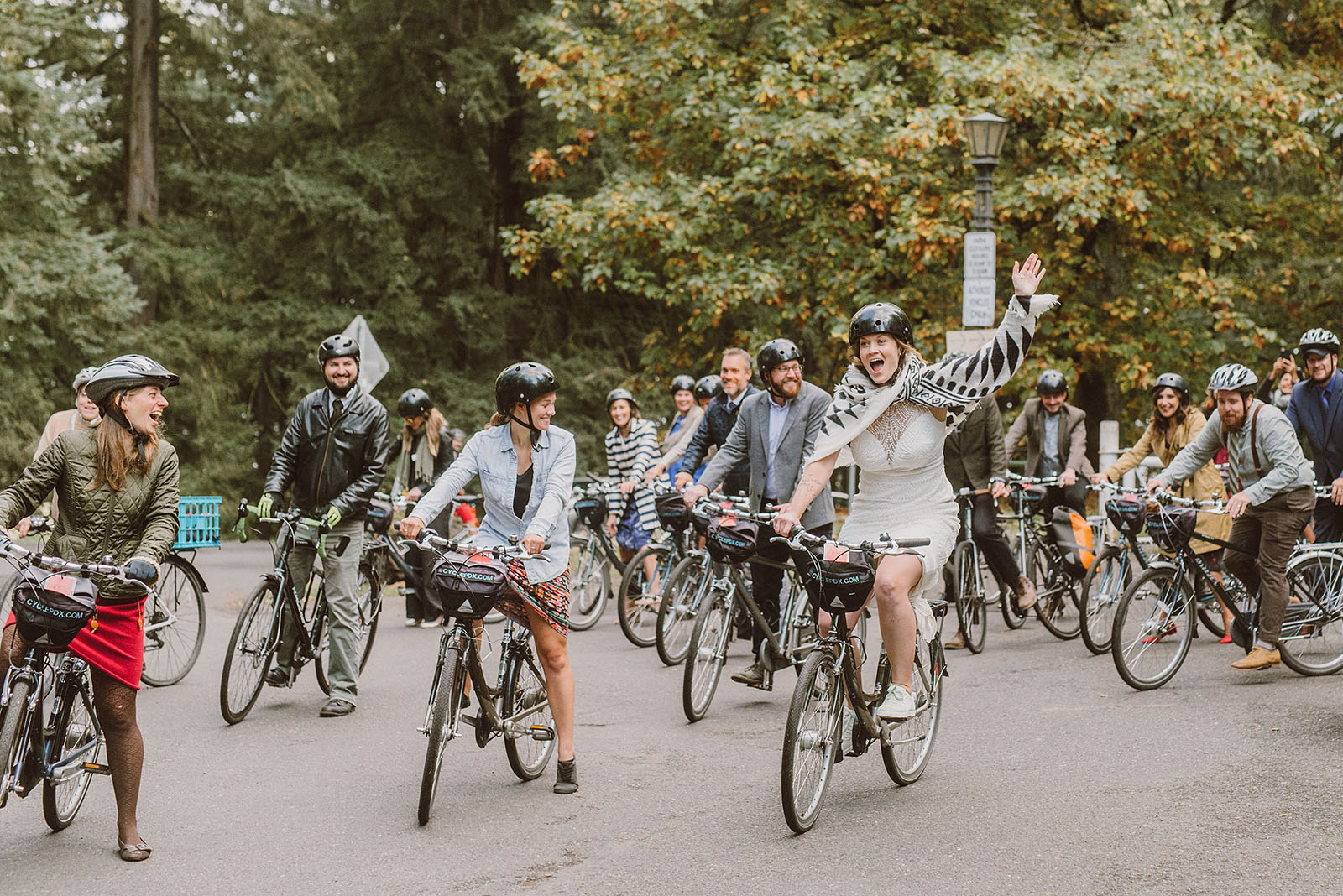 bride leading a bike parade from Mt Tabor - portland wedding photography